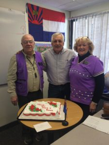 Former ESL volunteers, Steve and Roma Hurley, pose with Teacher Fred on their last day volunteering at KOM in February after almost 2 years.