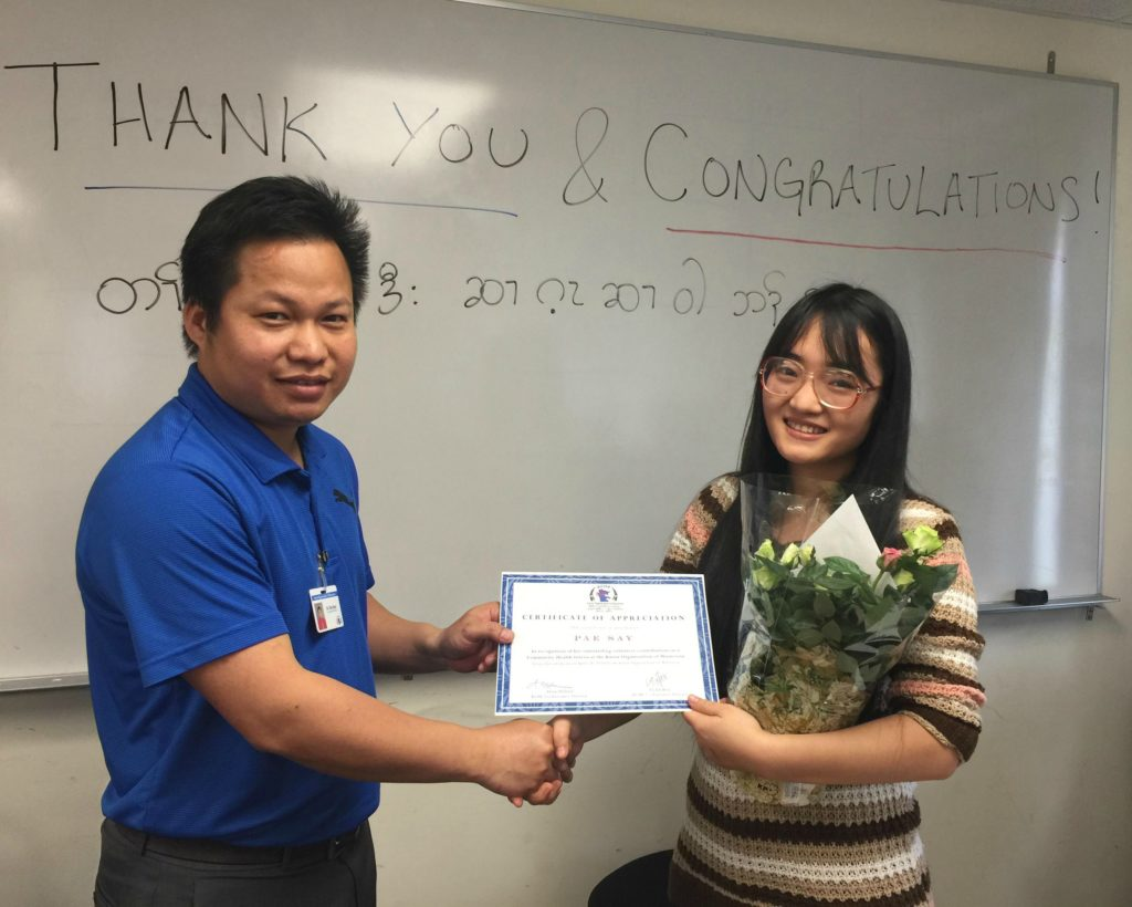Pae Say, our first Community Health Intern, accepts her certificate of appreciation on April 24, 2018 from KOM Co-Executive Director Eh Tah Khu