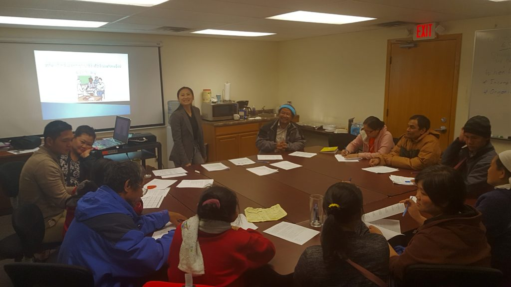 KOM staff Julyna Loo leading a parenting training class with Karen parents