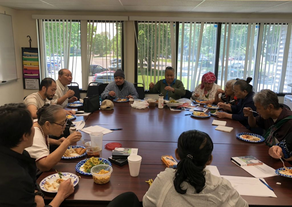 The elders enjoy a lunch together following the workshop.