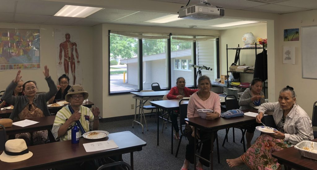 Elders sitting and participating in a workshop
