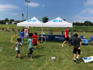 Kids playing activities at Blue Cross Blue Shield of Minnesota tents