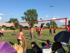 Women playing volleyball in the tournament finals
