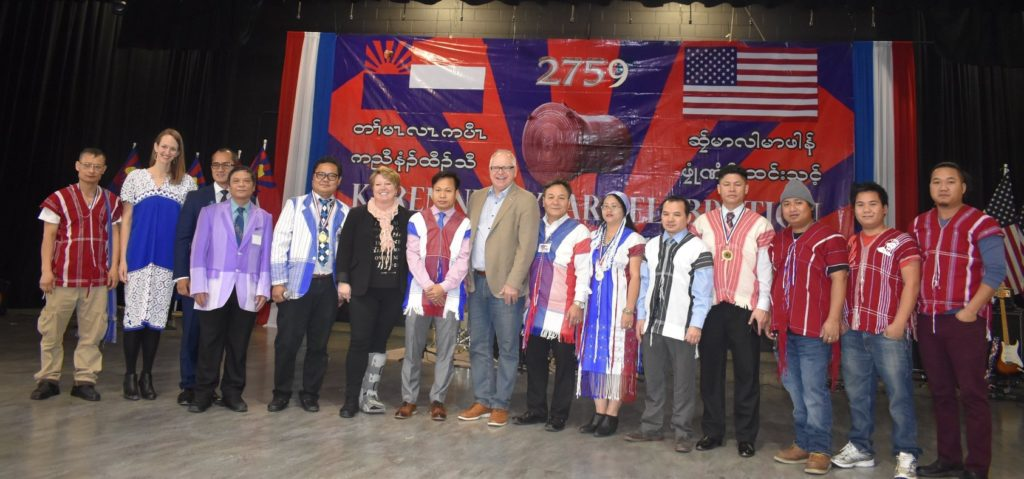 Governor Tim Walz poses at Karen New Year with KCM and KOM leaders and community members.