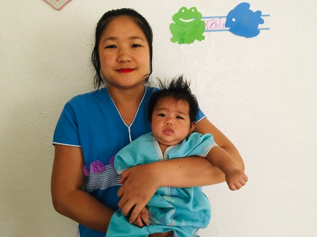 Mya Nay and her baby Shiny Bather. Mya Nay is one of the 37 mothers in KOM's Postpartum Home Visit Program.